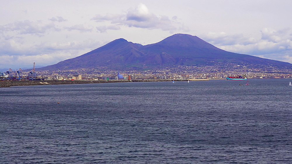 Day view of Mount Vesuvius, the active volcano, seen from the Gulf of Napoli, with buildings ashore, Naples, Campania, Italy, Europe - 1278-103