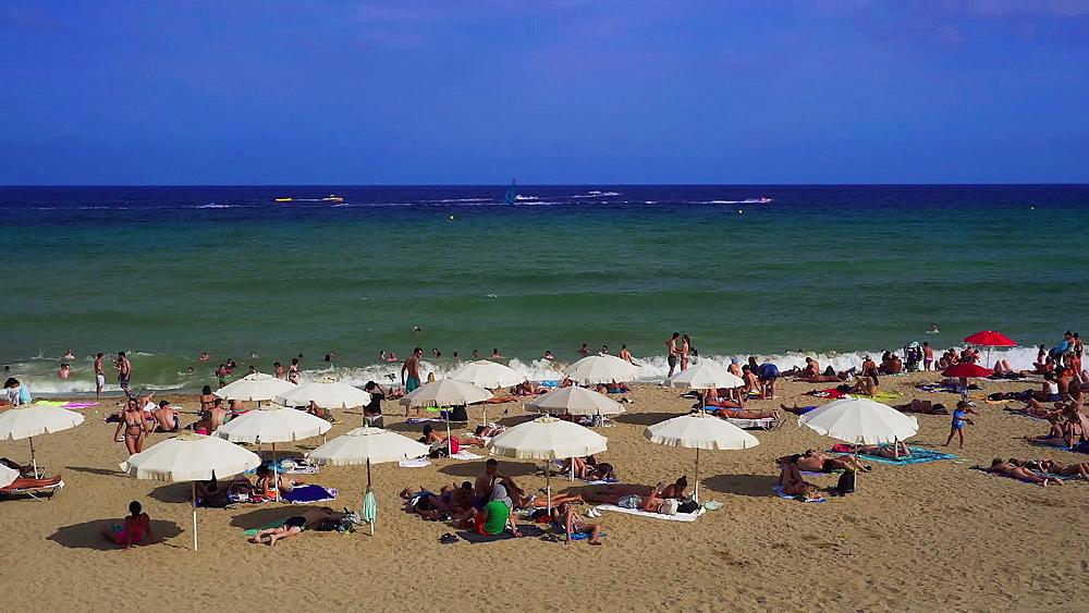 Barcelona Beach Catalonia, Spain. Bathers on sandy beach with sun umbrellas at the Mediterranean sea. - 1278-105