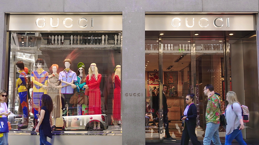Milan, Italy Via Monte Napoleone shopping street. Window shopping people outside Milano fashion district Gucci shop. - 1278-113