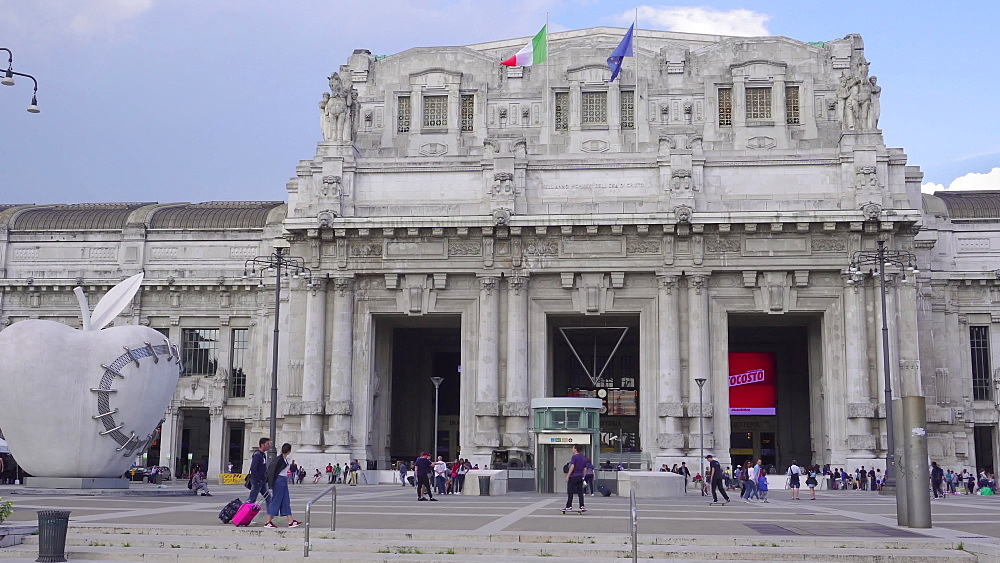 Milan Railway station facade with artwork, The Reintegrated Apple sculpture outside Milano Centrale at Piazza Duca d'Aosta, Milan, Lombardy, Italy, Europe - 1278-130