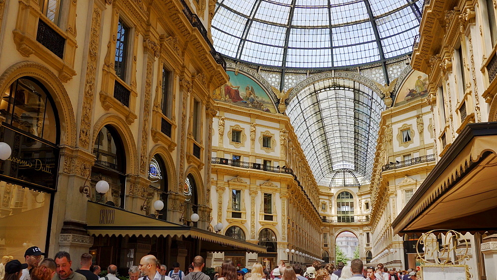 Galleria Vittorio Emanuele II at Piazza del Duomo with crowd inside historic glass domed mall with shops, Milan, Lombardy, Italy, Europe - 1278-134