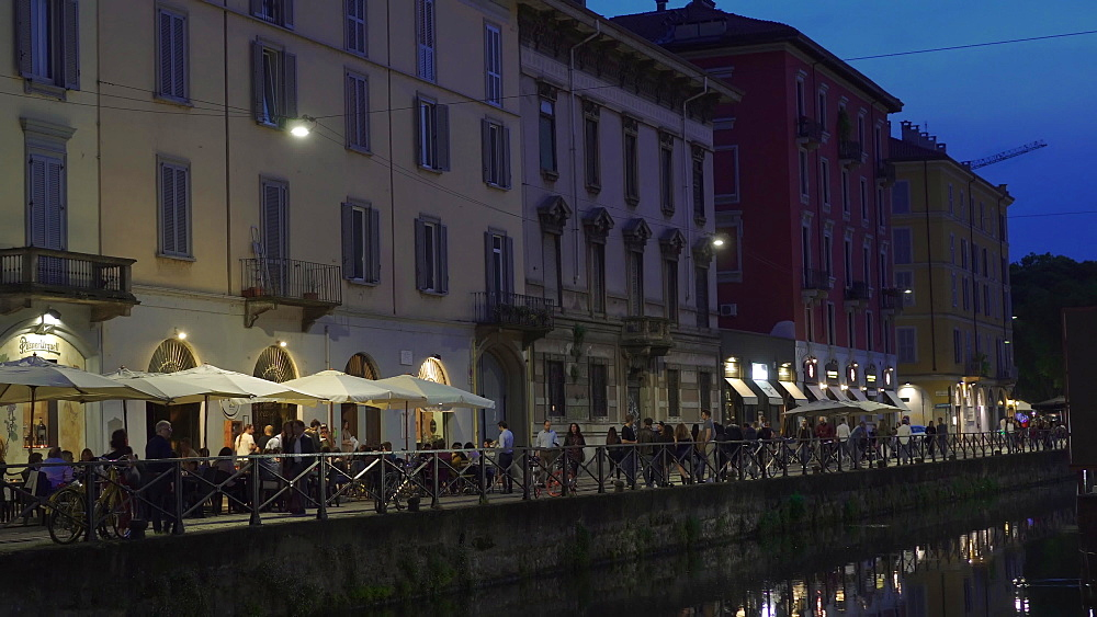 Naviglio Grande night view with crowd along the banks of the Navigli canal district with bars and restaurants, Milan, Lombardy, Italy, Europe - 1278-135