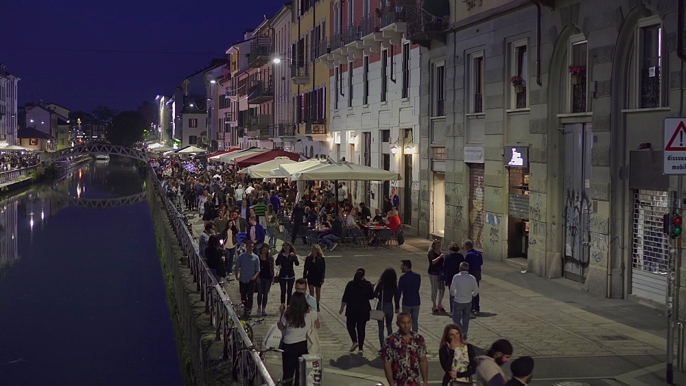 Milan, Italy Naviglio Grande night view. Crowd along the banks of the Navigli canal district with bars and restaurants. - 1278-136