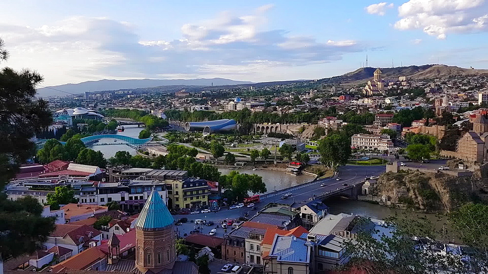 Day city view with Bridge of Peace, Holy Trinity Cathedral and old houses on Kura River, Tbilisi, Georgia, Central Asia, Asia - 1278-146