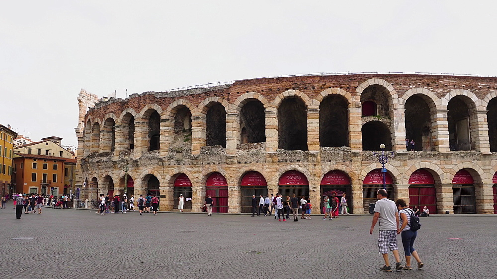 Arena di Verona, Italy external day view. Crowd outside Roman amphitheatre built in AD 30 in Piazza Bra. - 1278-147