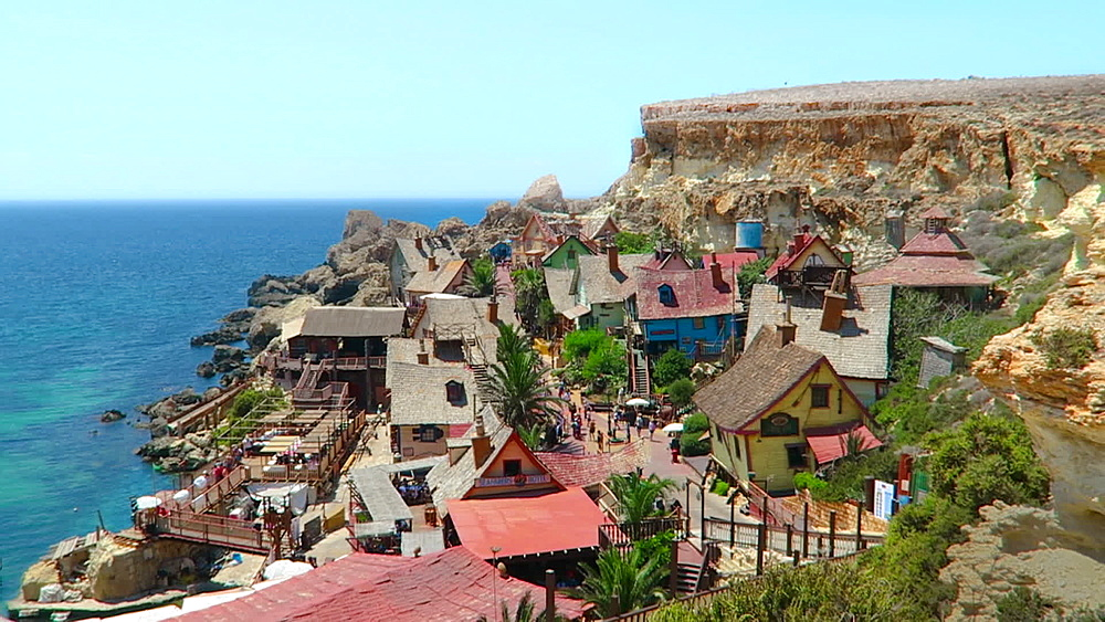 Panoramic view of street and houses of former 1980 film set, currently a theme park, Popeye Village, Malta, Mediterranean, Europe - 1278-151