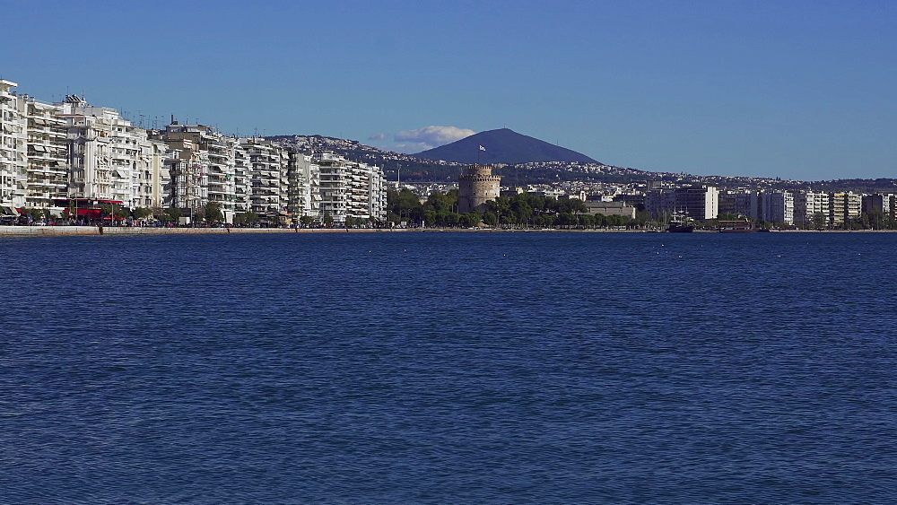 Old waterfront on left and new waterfront to right of landmark, with traffic on a sunny day, viewed from the city port area with the White Tower visible in the centre, Thessaloniki, Greece, Europe - 1278-18