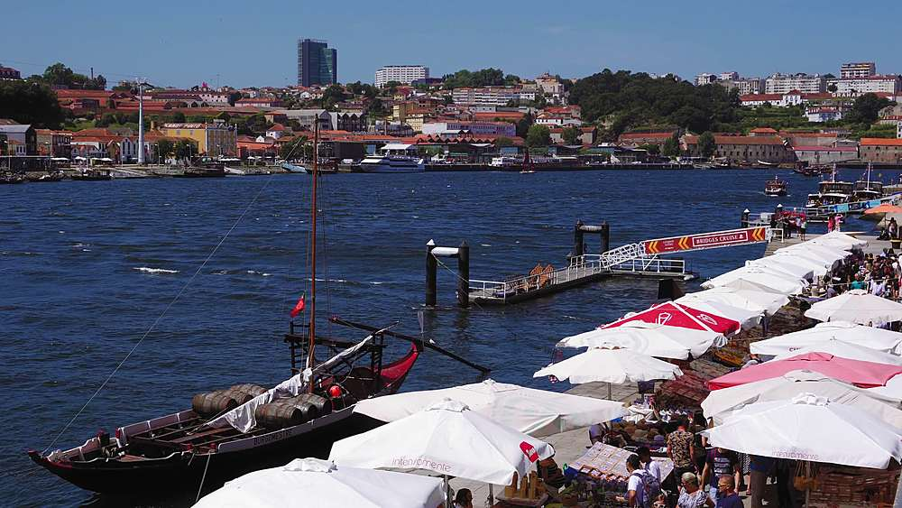 Porto, Portugal Ribeira souvenir stores. Day view of open air street stalls and markets with gift products on Duro river bank.
