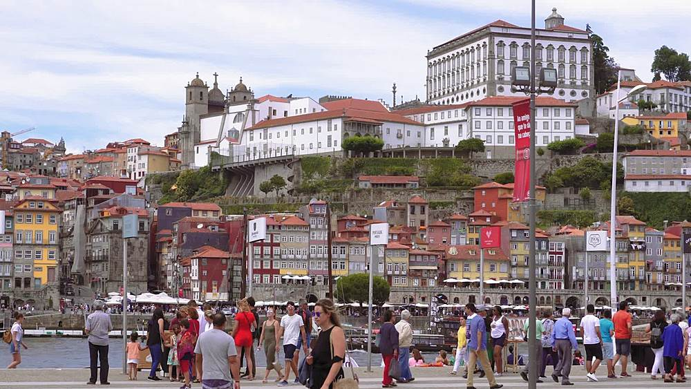 Porto, Portugal Ribeira traditional waterfront houses with tourists on Duro river bank, seen from Vila Nova de Gaia waterfront. - 1278-203