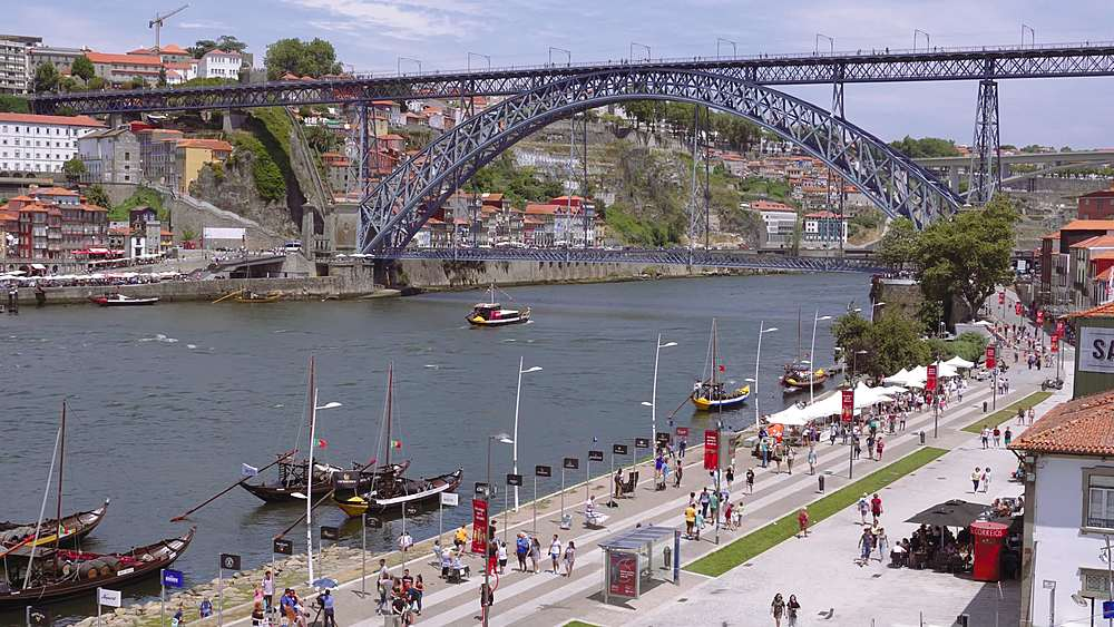 Porto, Portugal view of Dom Luis I bridge over Douro river. Vila Nova de Gaia waterfront with Porto wine ships & Ribeira view.