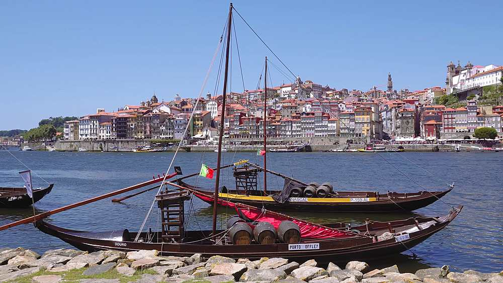 Porto, Portugal Vila Nova de Gaia waterfront ships. Douro river moored ships used to carry Porto wine with Ribeira background.