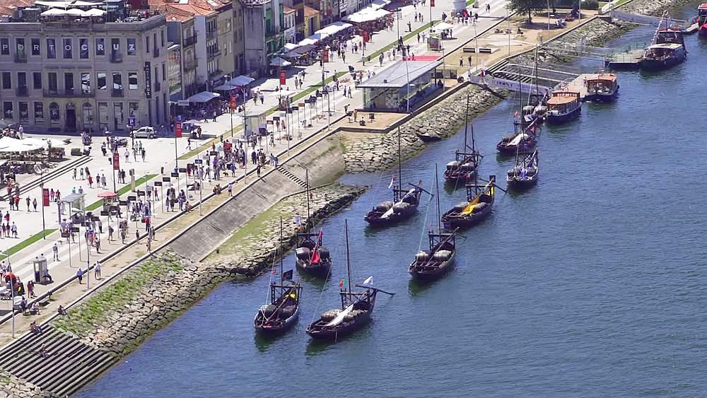 Porto, Portugal Vila Nova de Gaia waterfront panoramic view. Moored Douro river Porto wine boats before buildings and shops. - 1278-208