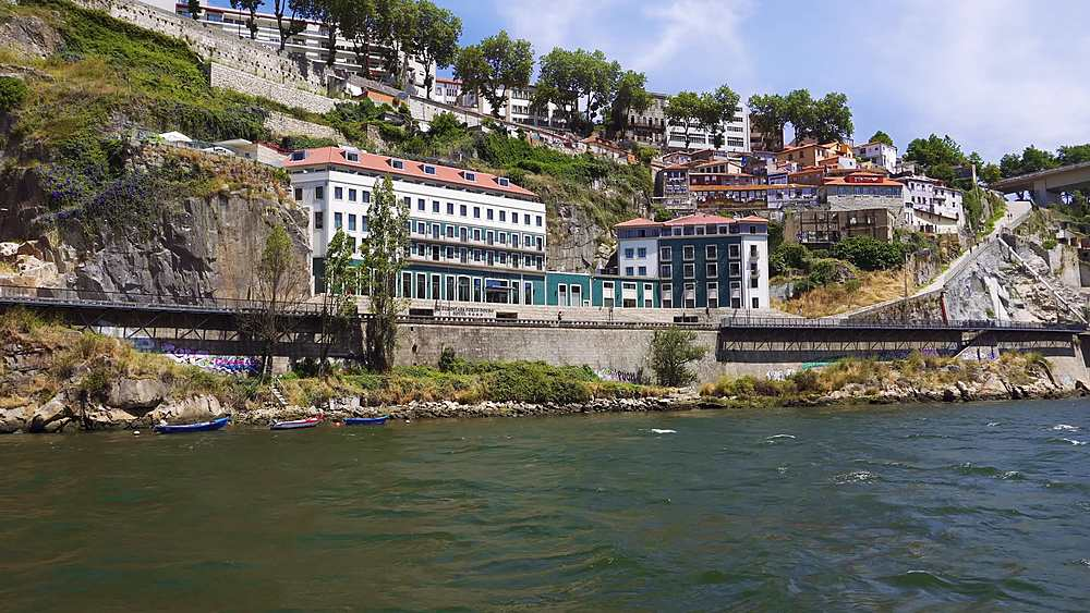 Porto, Portugal day view of buildings on the bank of Duro river, seen from sailing cruise ship.