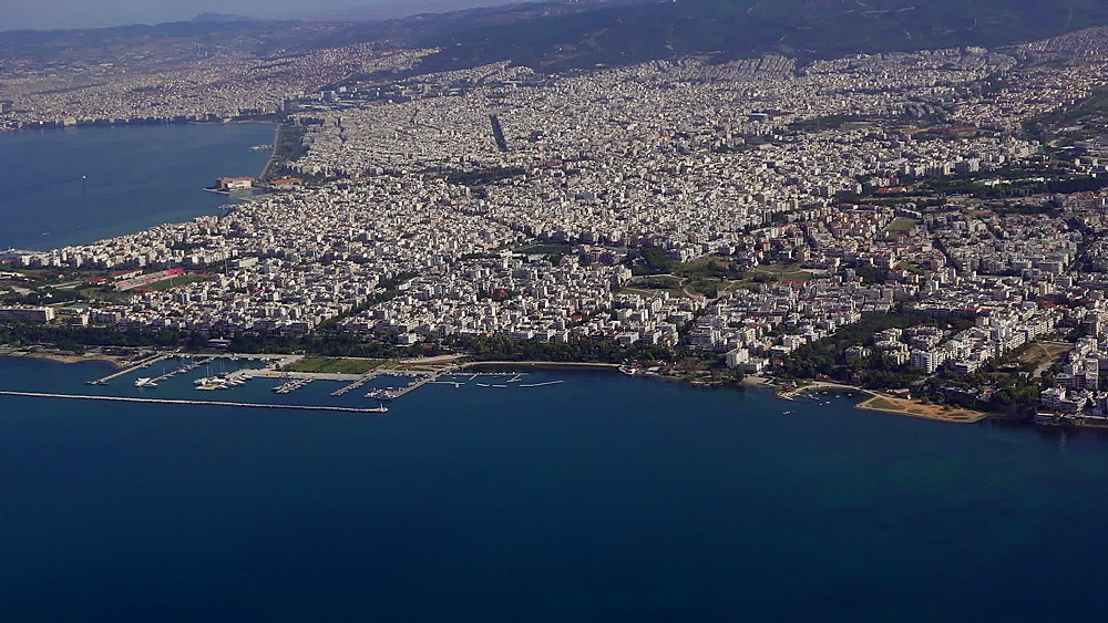 Aerial city day view taken from inside of inclining aircraft taking off from SKG international airport, Thessaloniki, Greece, Europe - 1278-30