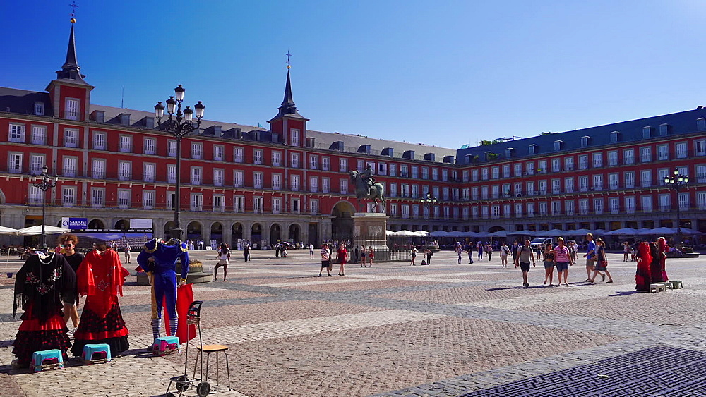 Madrid, Spain day view of Plaza Mayor with crowd. King Philip III Statue visible in the center of the square. - 1278-45