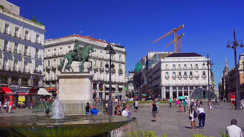 Madrid, Spain day view of Puerta Del Sol with crowd. Statue of King Charles visible - 1278-47