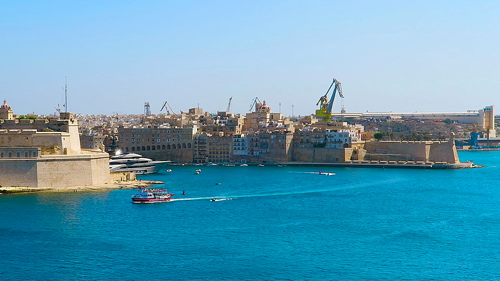 Day view of a small cruise ship sailing over the Grand Harbour, Valletta, Malta, Mediterranean, Europe - 1278-53