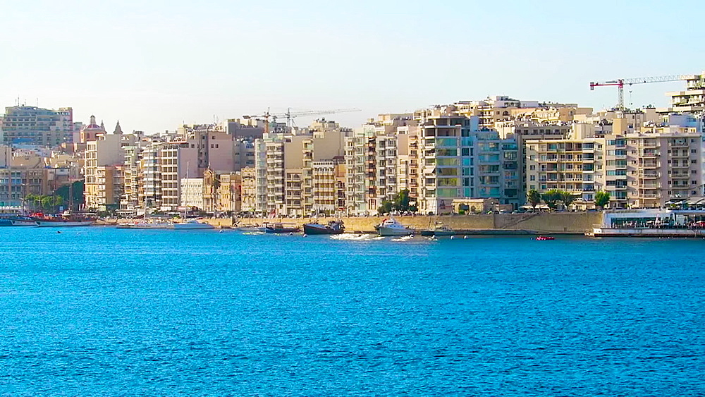 Valletta, Malta day view of Sliema with modern buildings and moored ships on the waterfront promenade. - 1278-54