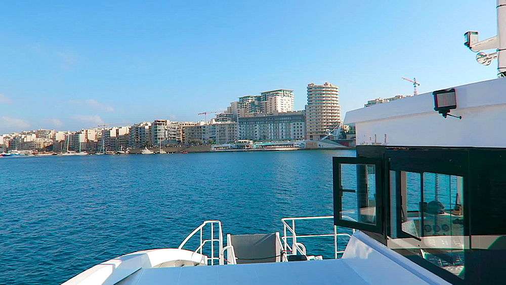 Day view of Sliema waterfront promenade with modern buildings as seen on the ferry boat from Valletta, Malta, Mediterranean, Europe - 1278-57