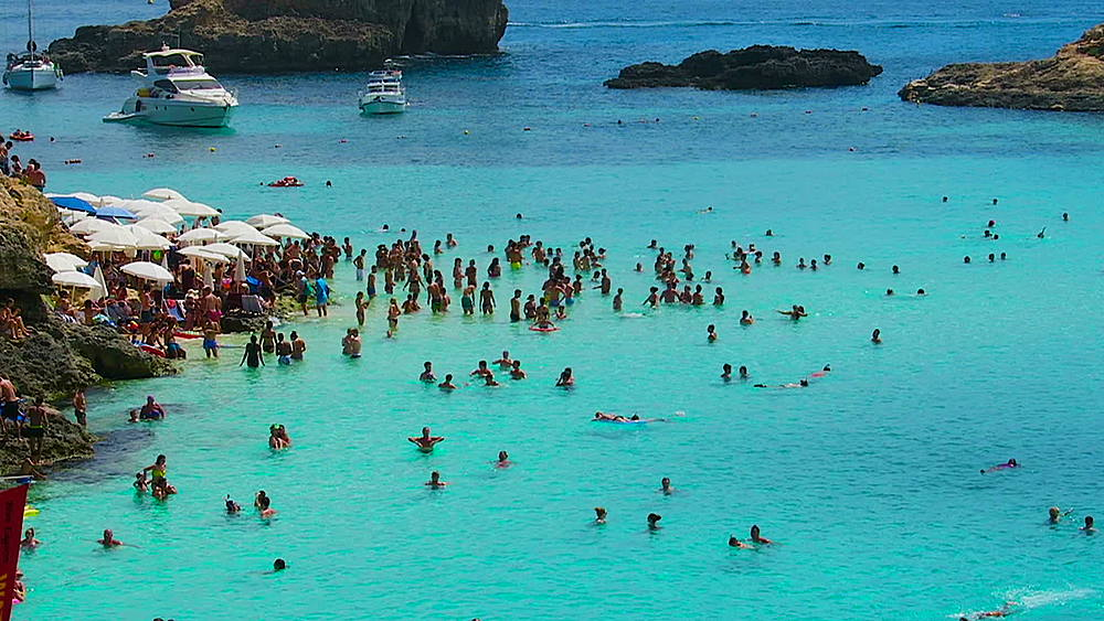 Comino Island, Malta Blue Lagoon tourists. Bathers at the crystal waters of the most famous beach in Malta. - 1278-62