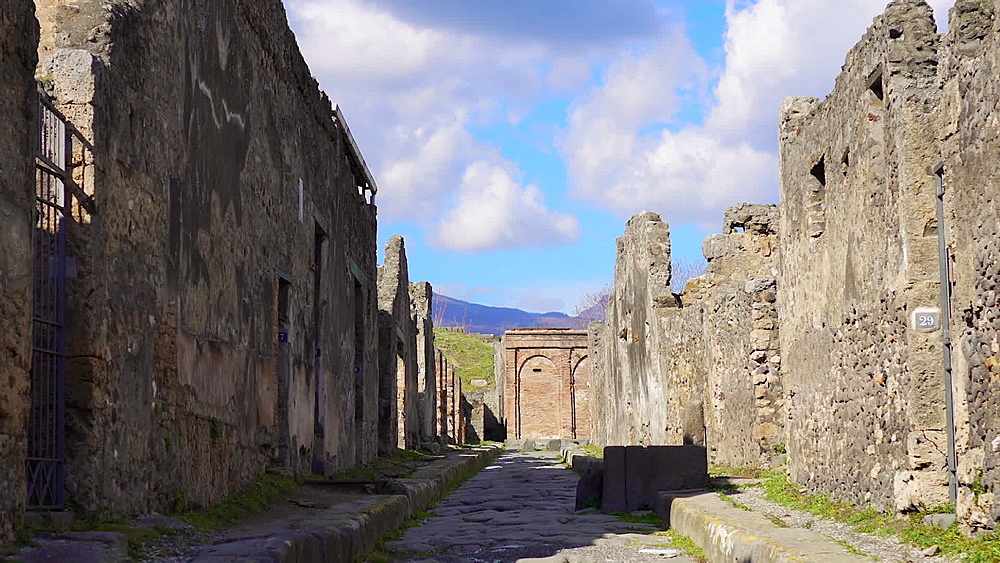 Remains of houses and structured formation of cobblestoned path to accommodate traffic inside the town, Pompeii, UNESCO World Heritage Site, Campania, Italy, Europe - 1278-89