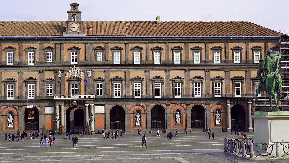 Naples, Italy Piazza del Plebiscito. Day view of the Royal Palace - Palazzo Reale di Napoli facade at the main public square. - 1278-98