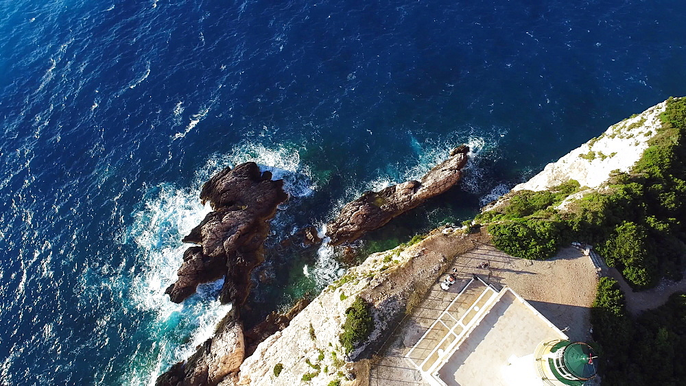 Aerial of Cape Lefkadas lighthouse, Lefkada, Ionian Islands, Greek Islands, Greece, Europe