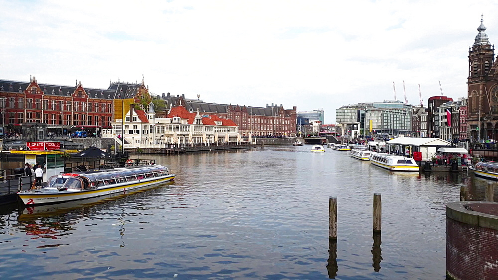 View of Basilika St. Nikolaus by Centraal station with ferry dock on the foreground, Amsterdam, North Holland, The Netherlands, Europe - 1300-381
