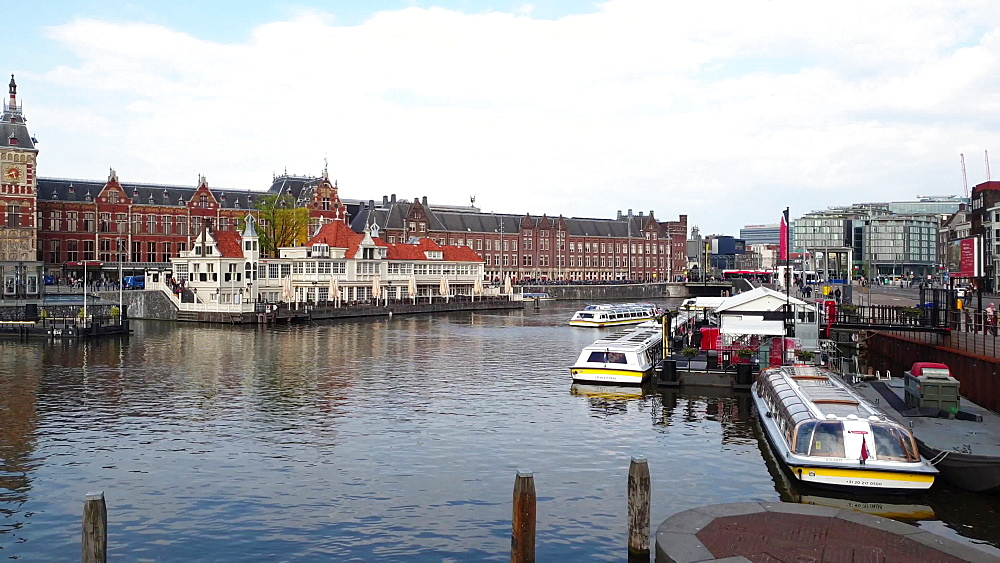 View of Basilika St. Nikolaus by Centraal station with ferry dock on the foreground, Amsterdam, North Holland, The Netherlands, Europe - 1300-384