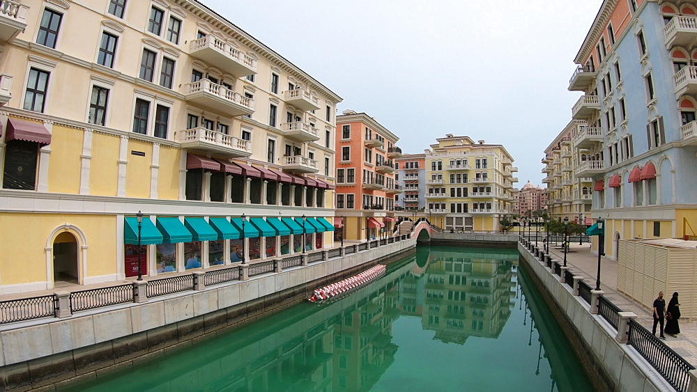 View of Venetian bridge reflecting on canals of picturesque and luxurious district icon of Doha, Venice at Qanat Quartier in the Pearl-Qatar, Doha, Qatar, Middle East