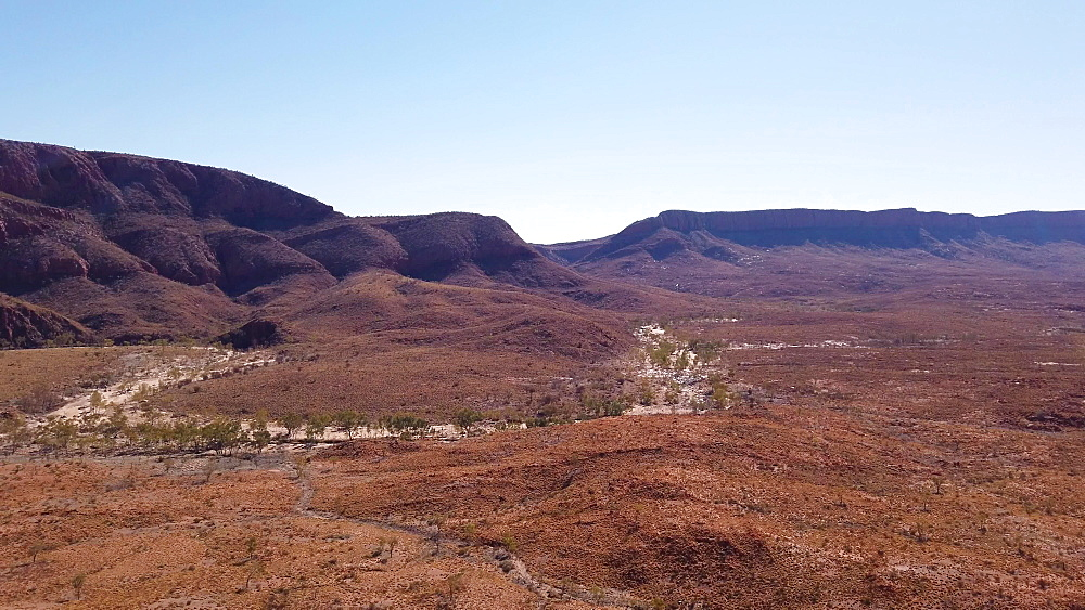 Panorama of Ormiston Gorge at lookout with Mount Sonder in the distance, during the Ormiston Pound Walk in West MacDonnell Ranges, Outback, Northern Territory, Australia, Pacific