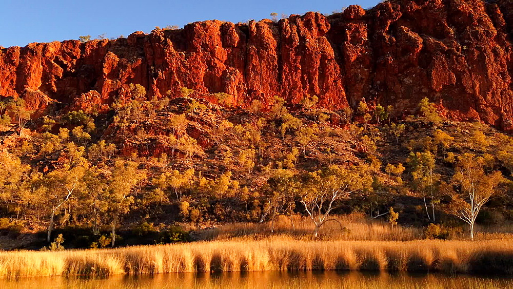 Time lapse of Glen Helen Gorge changing colours at sunset on permanent waterhole, West MacDonnell Ranges, rock formation along Red Center Way, Northern Territory, Australia, Pacific - 1314-165
