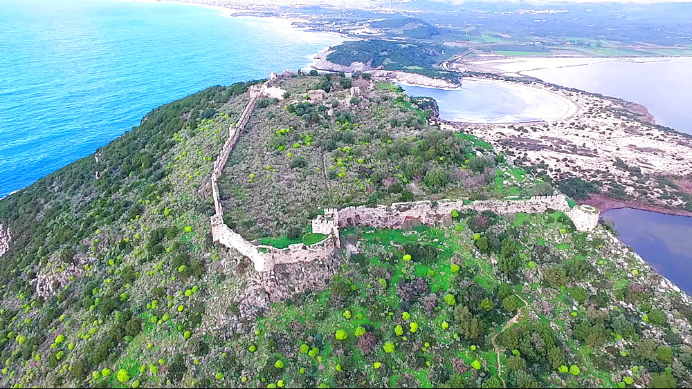 Aerial view of Palaiokastro (Old Navarino) castle with solitary visitor, near Pylos, Greece, Europe