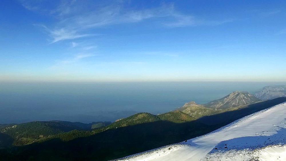 Aerial view of snow-covered Mount Dirfys (Dirfi) and the Aegean coast of Evia (Euboea) island, Greece, Europe