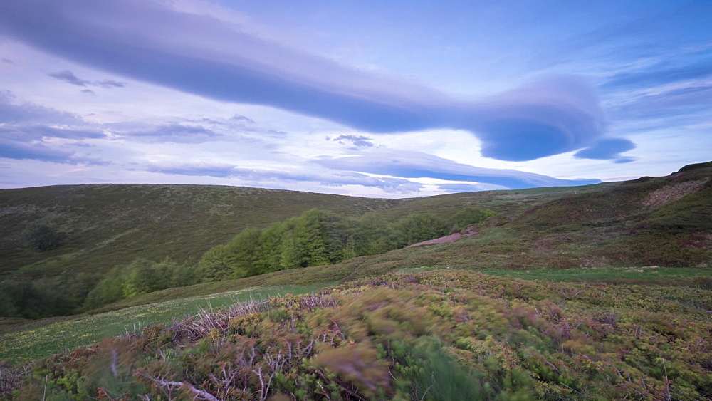 Time lapse of lenticular clouds and a mountain pasture landscape, Emilia Romagna, Italy, Europe