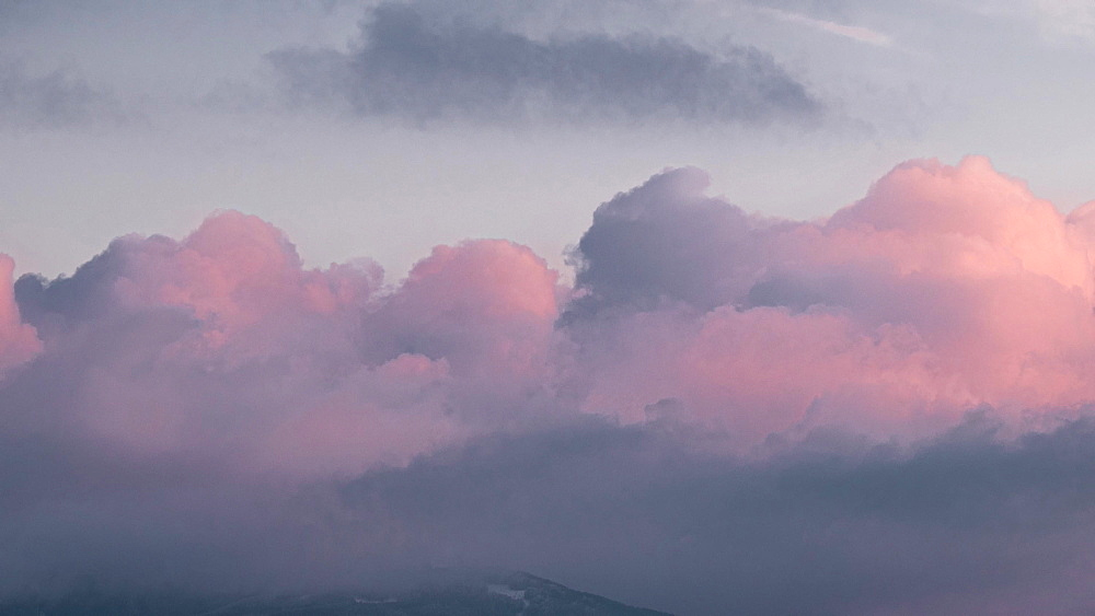 Time lapse of sunset light on moving clouds, Emilia Romagna, Italy, Europe