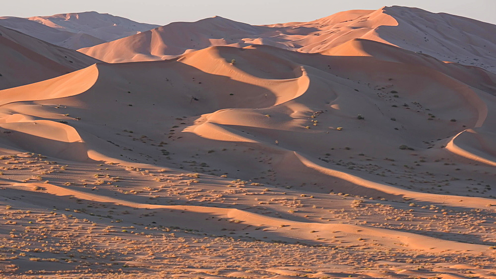 Time lapse at sunset on the sand dunes of the Rub al Khali desert (The Empty Quarter), Oman, Middle East
