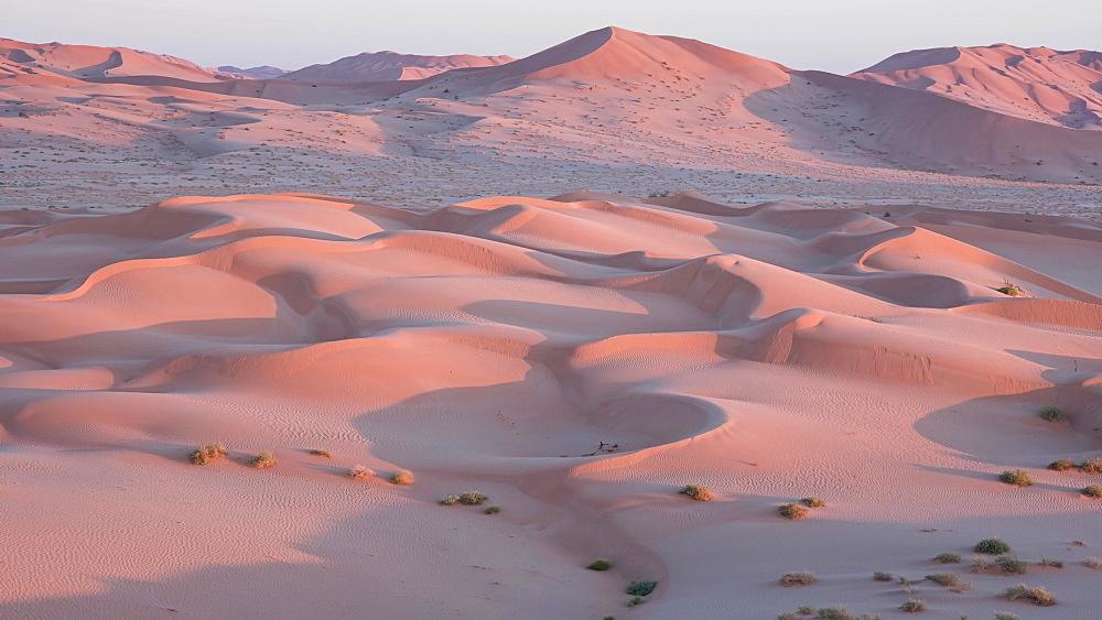Time lapse at sunrise on the sand dunes of the Rub al Khali desert (The Empty Quarter), Oman, Middle East