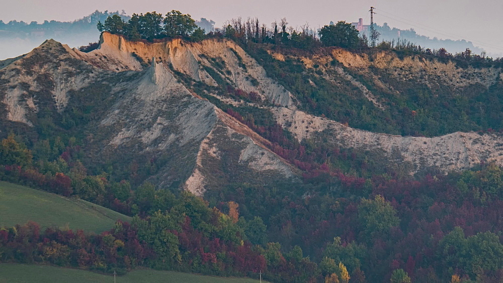 Time lapse of sunrise on badlands and a rock formation named Buzzard Tooth, Emilia Romagna, Italy, Europe