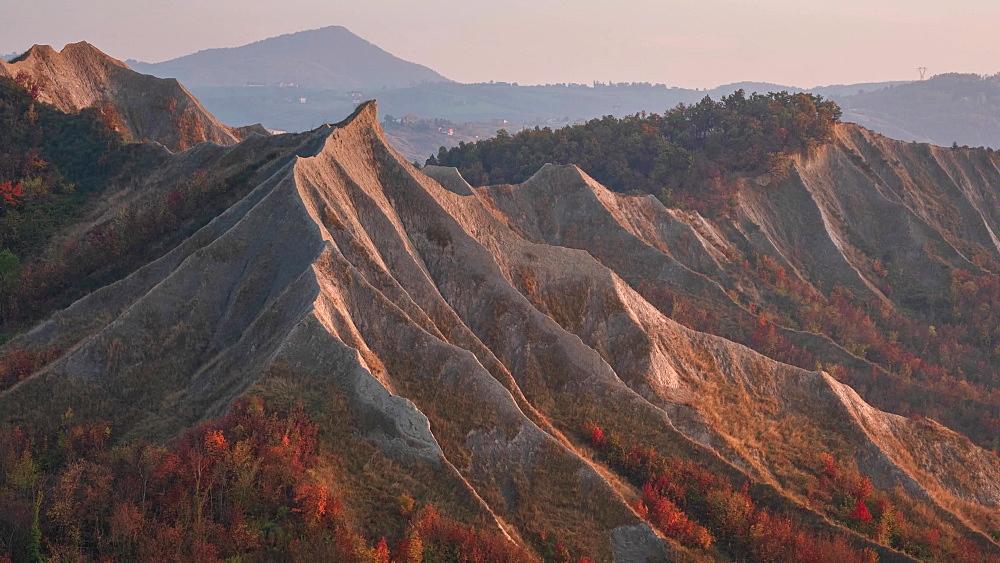 Time lapse of sunset on badlands in autumn with foliage, Emilia Romagna, Italy, Europe