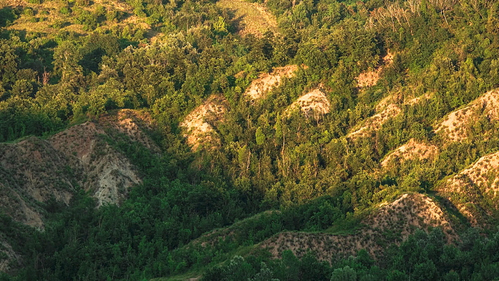 Time lapse of sunset on green badlands in summer, Emilia Romagna, Italy, Europe