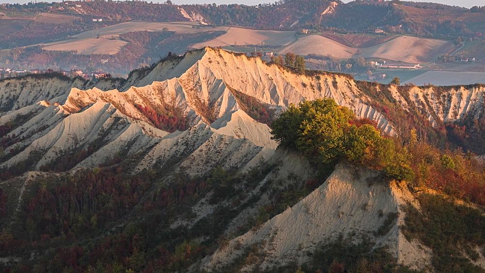 Time lapse of sunrise on badlands in autumn with foliage, Emilia Romagna, Italy, Europe