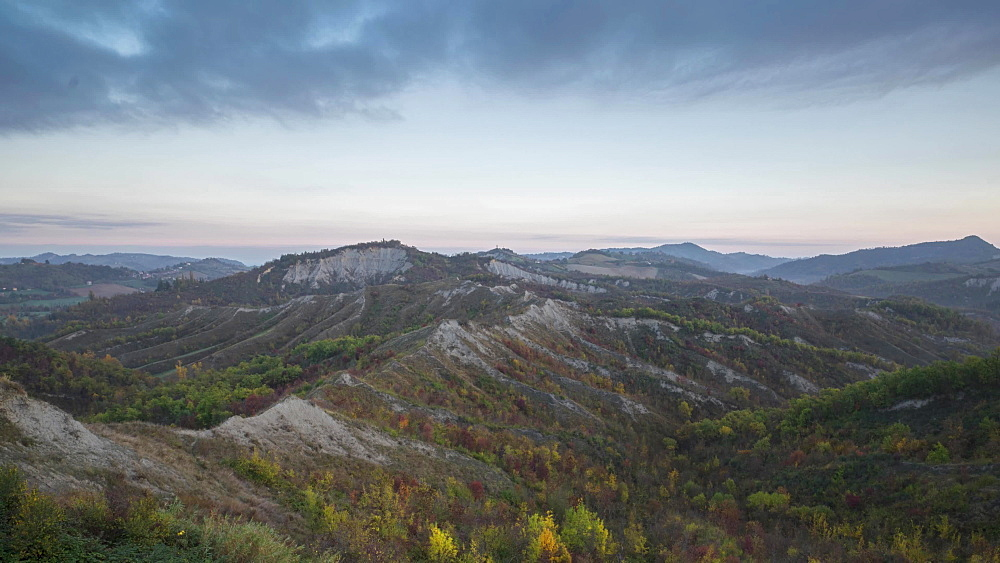 Time lapse of blue hour on badlands in autumn with moving clouds, Emilia Romagna, Italy, Europe