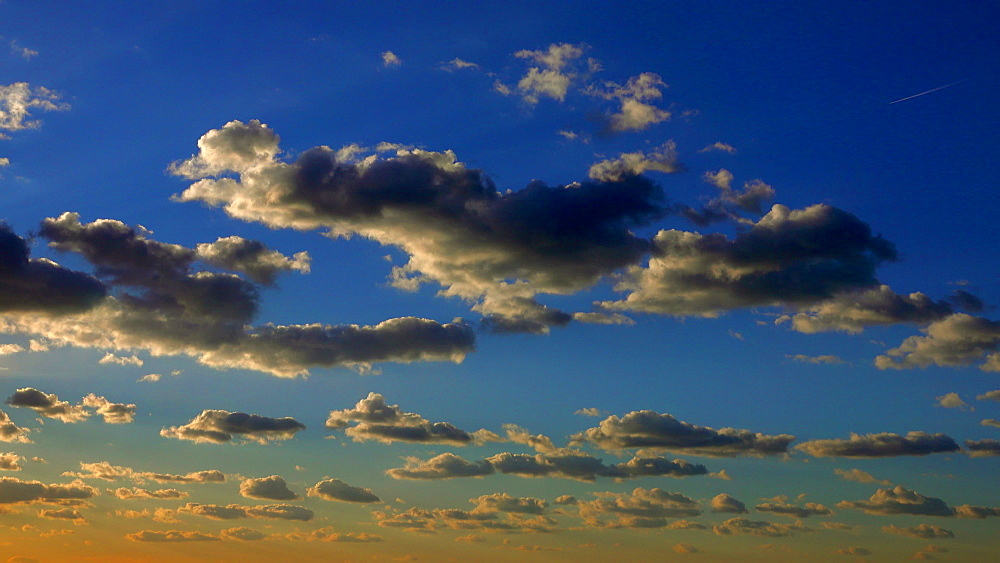 Dramatic clouds on blue sky in the evening, Saarland, Germany, Europe - 396-10315
