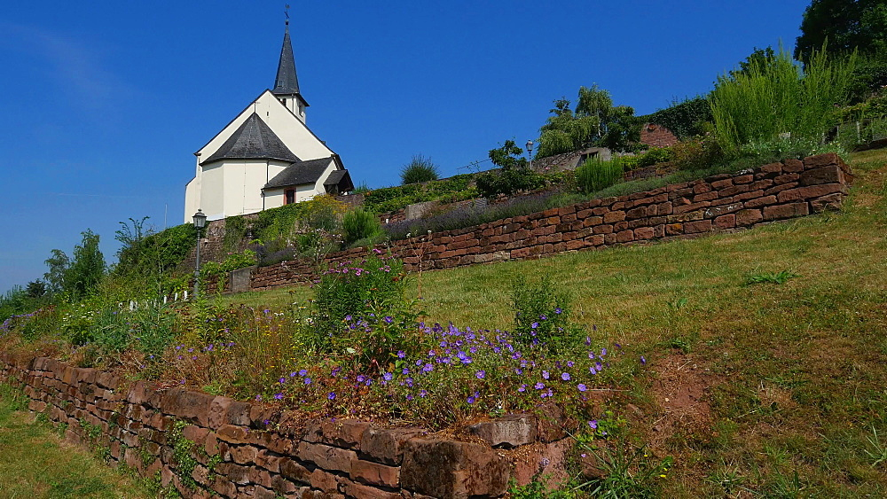 Garden and old Church of Saint Denis, Igel on the Moselle River near Trier, Rhineland-Palatinate, Germany, Europe