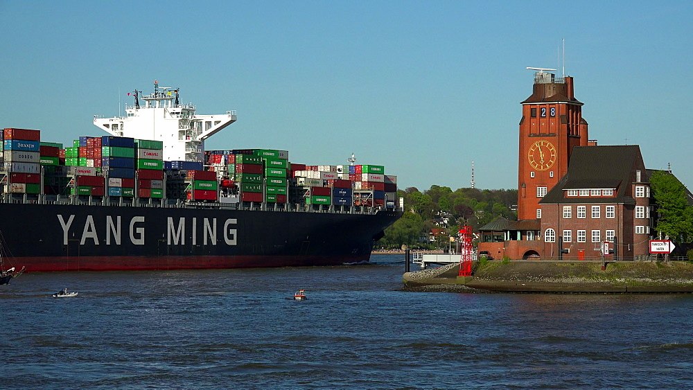 Cargo ships and Pilot Station on the Bank of Elbe River, Hamburg, Germany, Europe