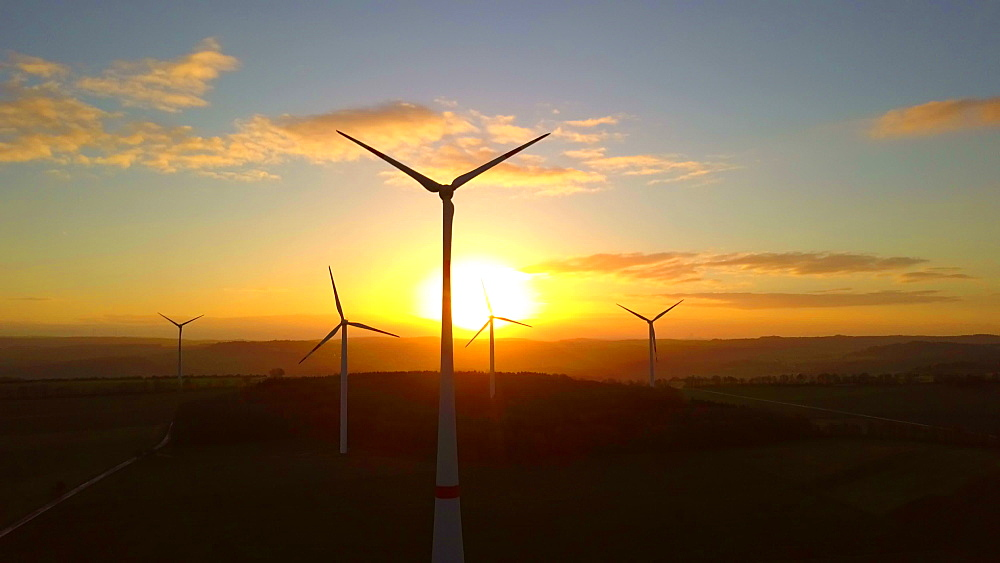 Aerial view of a wind farm in front of a sunrise, Saargau near Kirf, Rhineland-Palatinate, Germany, Europe