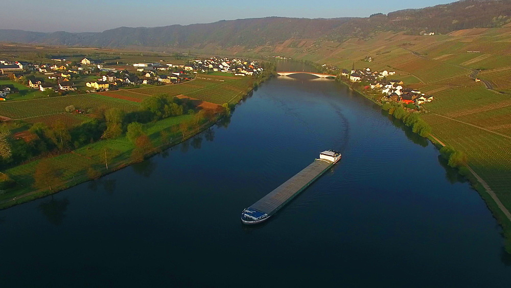 Aerial view of cargo vessel on Moselle River near Piesport, Rhineland-Palatinate, Germany, Europe