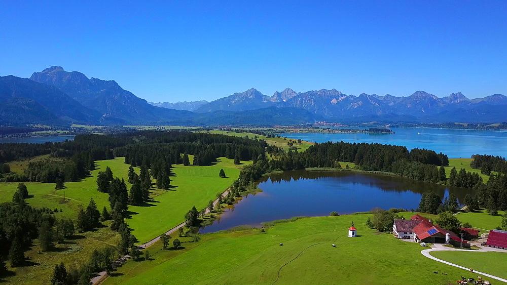 Aerial view of a chapel and a farm on Lake Hergratsried and Lake Forggensee near F?ssen, Allgaeu, Swabia, Bavaria, Germany - 396-8387