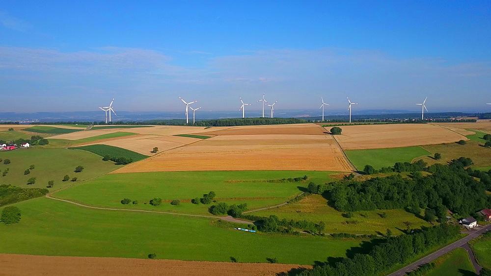 Aerial view of farmland and wind turbines near the town of Meurich, Saargau, Rhineland-Palatinate, Germany